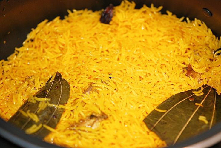 layering of chicken in chicken biryani prepration recipe at yourfoodfantasy.com by meenu gupta