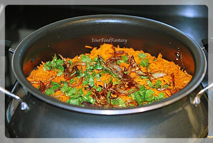 layering of chicken in chicken biryani prepration recipe-at yourfoodfantasy.com by meenu gupta