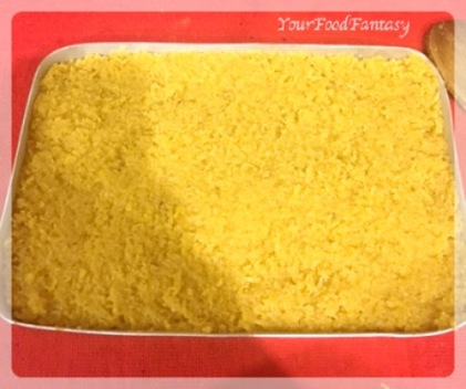 Setting the Barfi in a tray   Coconut Barfi Recipe